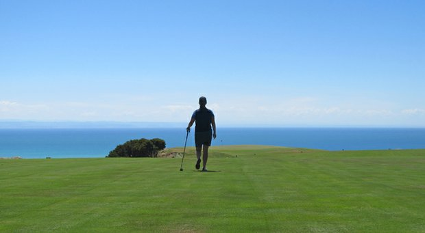 "Beth Ann Baldry walks down the fairway at No. 12 at Cape Kidnappers in New Zealand. Baldry: ""It's called 'infinity' for obvious reasons."""