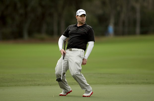 Jon Ritchey, reacts to his putt at No. 9 while playing with David Duval in the PNC Father/Son Challenge Pro-Am at The Ritz Carlton Golf Club of Orlando.