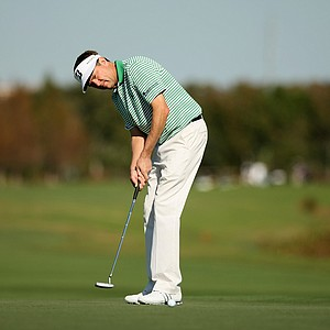 Davis Love III putts at No. 18 during the PNC Father/Son Challenge Pro-Am at The Ritz Carlton Golf Club of Orlando.