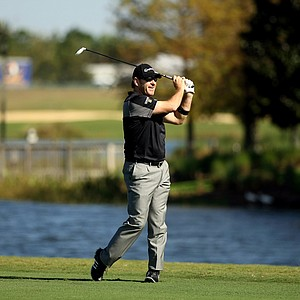 Nick Faldo hits his shot at No. 18 during the PNC Father/Son Challenge Pro-Am at The Ritz Carlton Golf Club of Orlando.