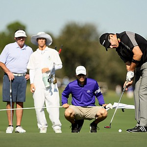 Nick Faldo putts under some watchful eyes at the PNC Father/Son Challenge Pro-Am at The Ritz Carlton Golf Club of Orlando.