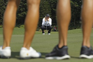 Suzann Pettersen of Norway, lines up her putt on the 2nd hole green during the last day of the LPGA Taiwan Championship tournament at the Sunrise Golf & Country Club, Sunday, Oct. 27, 2013, in Yangmei, northern Taiwan.
