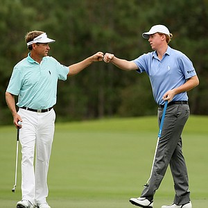 Defending champions, Davis Love III and his son Dru Love, right, on Saturday at the PNC Father/Son Challenge at The Ritz Carlton Golf Club of Orlando. They posted a 64 in Round 1