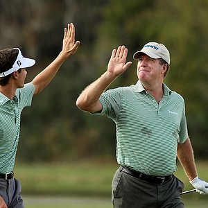 Steve Elkington and his son, Sam, celebrate an eagle at No. 14 on Saturday at the PNC Father/Son Challenge at The Ritz Carlton Golf Club of Orlando.