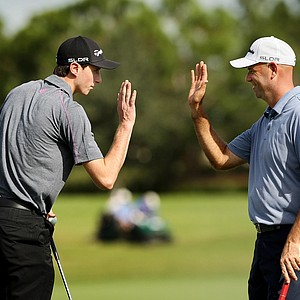 Stewart Cink and his son, Connor, are in the lead after the first round on Saturday at the PNC Father/Son Challenge at The Ritz Carlton Golf Club of Orlando.