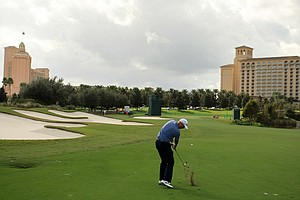 Stewart Cink hits a shot at No. 16 on Saturday at the PNC Father/Son Challenge at The Ritz Carlton Golf Club of Orlando.