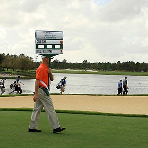 The pairing of Stewart Cink and David Duval make their way down No. 17 on Saturday at the PNC Father/Son Challenge at The Ritz Carlton Golf Club of Orlando.