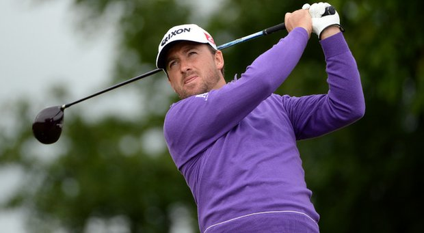 One of Graeme McDowell's signature colors is purple because it's the color on his family crest.