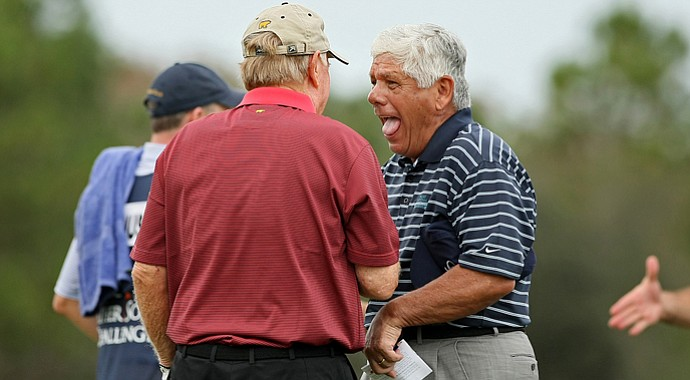 Lee Trevino jokes with Jack Nicklaus on No. 18 during Saturday's round at the PNC Father/Son Challenge at The Ritz Carlton Golf Club of Orlando.