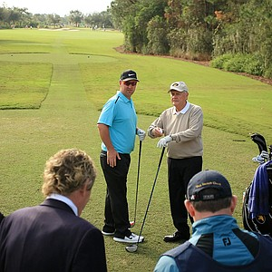 Jack Nicklaus and David Duval talk on the first tee on Sunday at the PNC Father/Son Challenge at The Ritz Carlton Golf Club of Orlando.