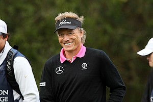 Bernhard Langer smiles to Christina, his daugher, after her first drive on Sunday at the PNC Father/Son Challenge at The Ritz Carlton Golf Club of Orlando.