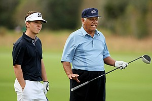 Lee Trevino with his son, Daniel, on Sunday at the PNC Father/Son Challenge at The Ritz Carlton Golf Club of Orlando.