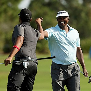 Vijay Singh celebrates with his son Qass on Sunday at the PNC Father/Son Challenge at The Ritz Carlton Golf Club of Orlando.