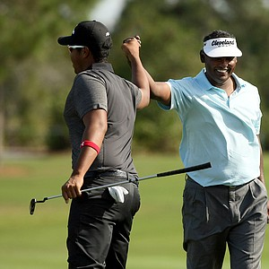Vijay Singh celebrates with his son, Qass, on Sunday at the PNC Father/Son Challenge at The Ritz Carlton Golf Club of Orlando.