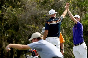 Stewart Cink and his son Connor, celebrate a birdie, while Steve Elkington lines up his putt on Sunday at the PNC Father/Son Challenge at The Ritz Carlton Golf Club of Orlando.
