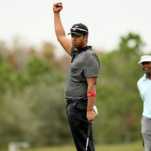 Qass Singh, son of Vijay Singh, makes birdie at No. 18 on Sunday at the PNC Father/Son Challenge at The Ritz Carlton Golf Club of Orlando.