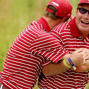 Alabama's Justin Thomas mobs head coach Jay Seawell after they won at the 2013 NCAA Championship at Capital City Club Crabapple Course.