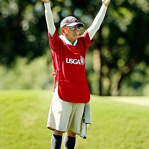 Delin Feng signals to his daughter, Yueer Cindy Feng, for the direction of her shot during the final round of match play at the 2013 U. S. Women's Amateur at Country Club of Charleston.