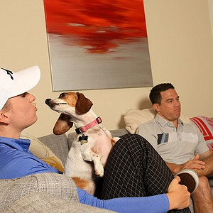 Jodi Ewart Shadoff with her husband Adam Shadoff with her two dogs, Bacon and Zia, in her Sarasota home.