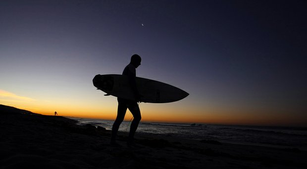 Dave Ortley of Oakley prepares to head into the water at the Trestles area of San Clemente.