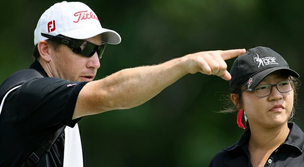 Lydia Ko with then-coach and caddie Guy Wilson during the 2011 U.S. Women's Amateur.