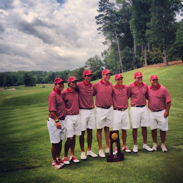 Alabama after winning the 2013 NCAA Championship.