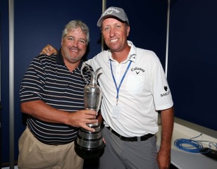 "Golfweek Editor Jeff Babineau (left) holds the Claret Jug after Phil Mickelson's caddie, Jim ""Bones"" Mackay, made the rounds with it at the PGA Championship."