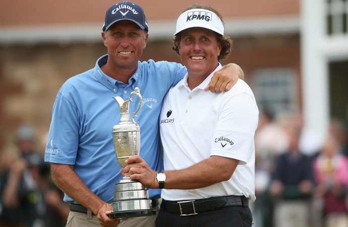 "Phil Mickelson (right) and caddie Jim ""Bones"" Mackay hold the Claret Jug after a brilliant final round gave Mickelson his first Open Championship title."