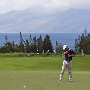 Adam Scott reacts to a missed birdie putt on the third green during the first round of the Tournament of Champions.