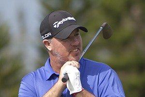 Boo Weekley reacts to a chip off the second green during the first round of the Tournament of Champions.