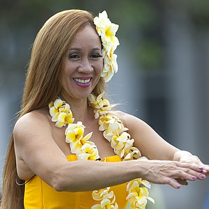 Mapuana Samonte-Nowak performs a hula dance before the start of the first round of Tournament of Champions.