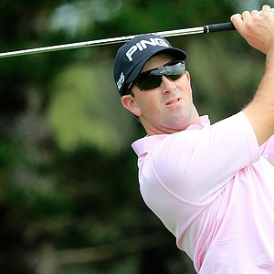 Michael Thompson plays a shot on the 2nd hole during the first round of the Hyundai Tournament of Champions.