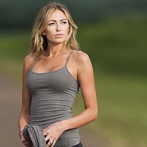 Paulina Gretzky is seen near the 18th fairway during the first round of the Tournament of Champions golf tournament, Friday, Jan. 3, 2014, in Kapalua, Hawaii. Gretzky, daughter of hockey great Wayne Gretzky, is engaged to golfer Dustin Johnson who is playing in the tournament.