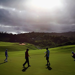 Harris English and Patrick Reed approach the green during Round 2 of the Hyundai Tournament of Champions.