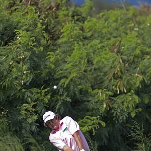 Jason Dufner hits out of the grass near the 14th green during the second round of the Tournament of Champions.