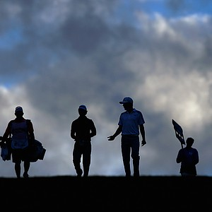 Derek Ernst and Jonas Blixt walk down a fairway during Round 2 of the Hyundai Tournament of Champions.