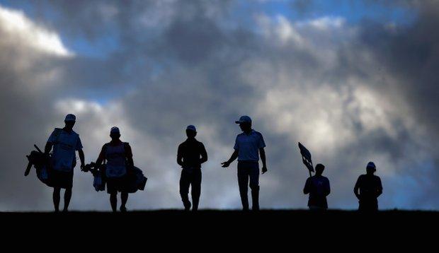 Derek Ernst and Jonas Blixt walk down a fairway during Round 2 of the Hyundai Tournament of Champions.