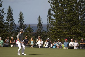 Jordan Spieth reacts to his long putt on the second green during the second round of the Tournament of Champions.