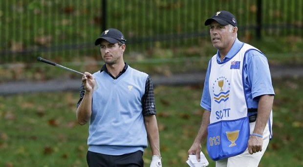 Caddie Steve Williams will not work with Adam Scott during the 2014 Sony Open in Hawaii (shown during last year's Presidents Cup).