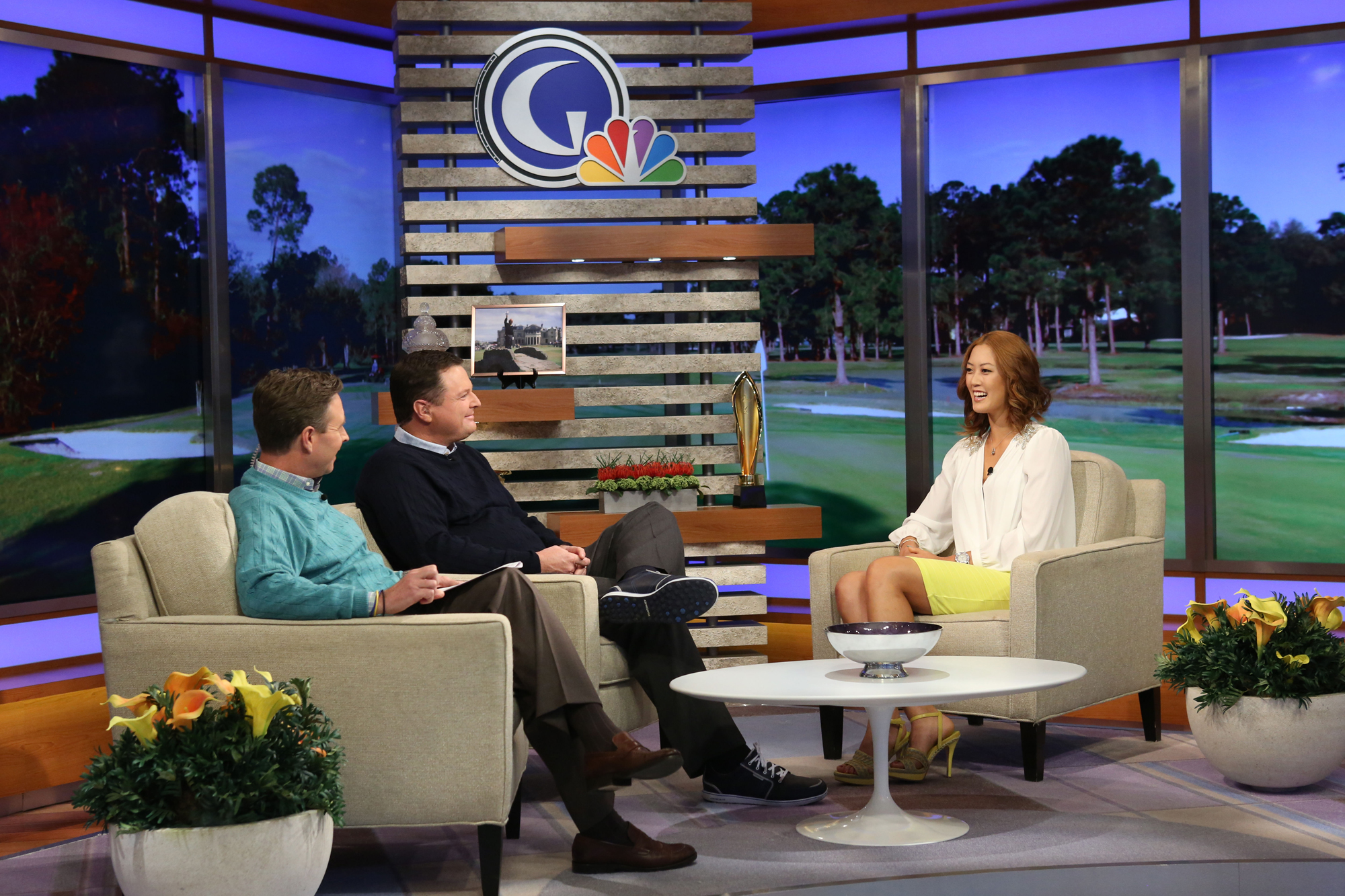 Gary Williams (left) and Charlie Rymer talk with Michelle Wie during her first visit to the Golf Channel Studios in Orlando, Fla.