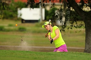 Emmy Martin hits out of the bunker at No. 1 during the 59th Harder Hall Women's Invitational at Harder Hall Country Club.
