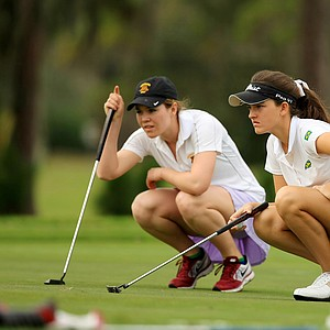 Luiza Altmann, foreground, and Sophie Kitchen, background, look over their putts at No. 1 during the 59th Harder Hall Women's Invitational at Harder Hall Country Club.