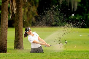Luiza Altmann hits out of the bunker at No. 9 during the 59th Harder Hall Women's Invitational at Harder Hall Country Club.