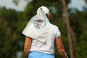 Martha Leach drapes the pin over her shoulder during the 59th Harder Hall Women's Invitational at Harder Hall Country Club.