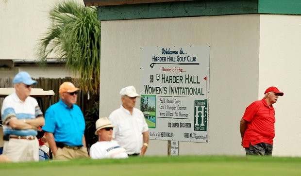 Spectators watch the action at the ninth green during the third round of the 59th Harder Hall Women's Invitational at Harder Hall Country Club.