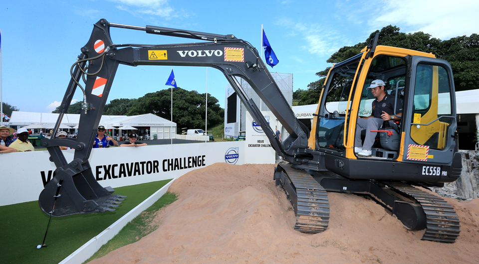 Louis Oosthuizen takes the controls of a Volvo excavator after his victory at the Volvo Golf Champions on Sunday.