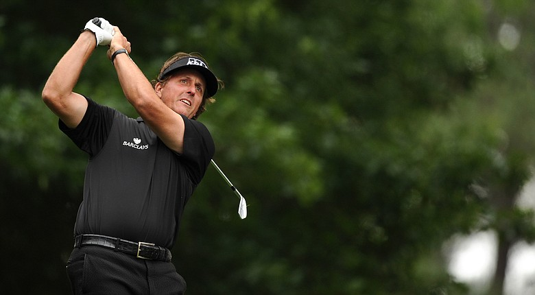 Phil Mickelson tees off on the fourth hole during the second round of the 76th Masters golf tournament at Augusta National.