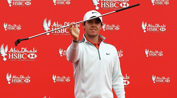 Rory McIlroy practices some local dancing during a photo call prior to the start of the Abu Dhabi HSBC Championship.