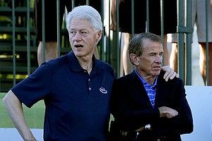 Former President Bill Clinton and PGA Tour Commissioner Tim Finchem at the start of the 2014 Humana Challenge in La Quinta, Calif.