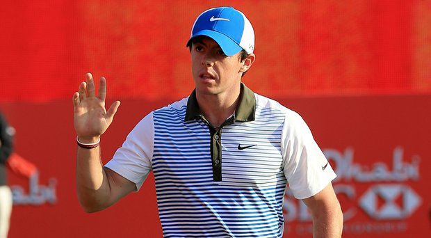 Rory McIlroy fired a 5-under 67 on Friday to move within two shots of the lead in Abu Dhabi.